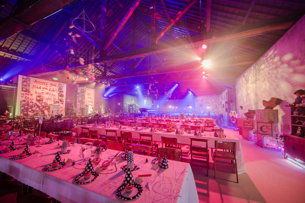 A large, blank canvas event Space with wooden beams and high ceilings