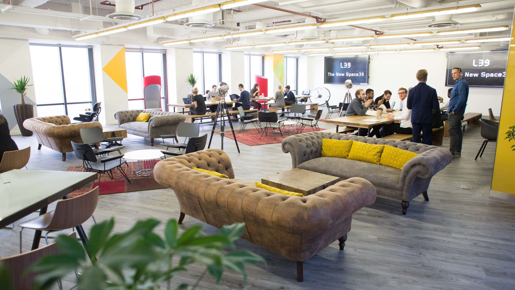 A large co-working space with sofas and chairs