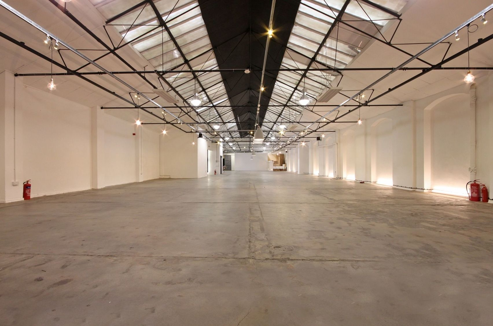 The Yard : a large warehouse with pointed ceiling