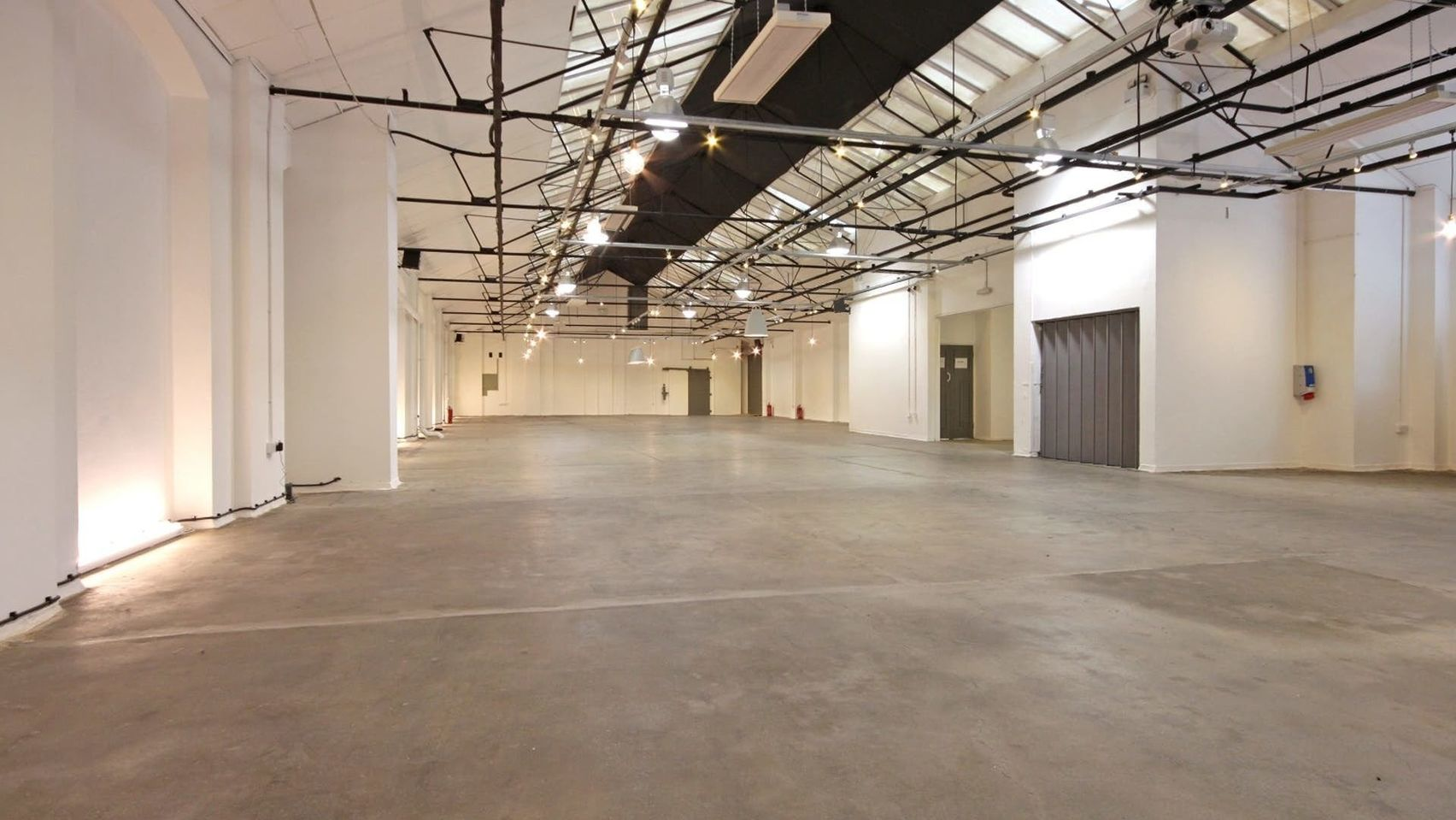 The Yard Shoreditch is a blank canvas Space with white walls and black beams