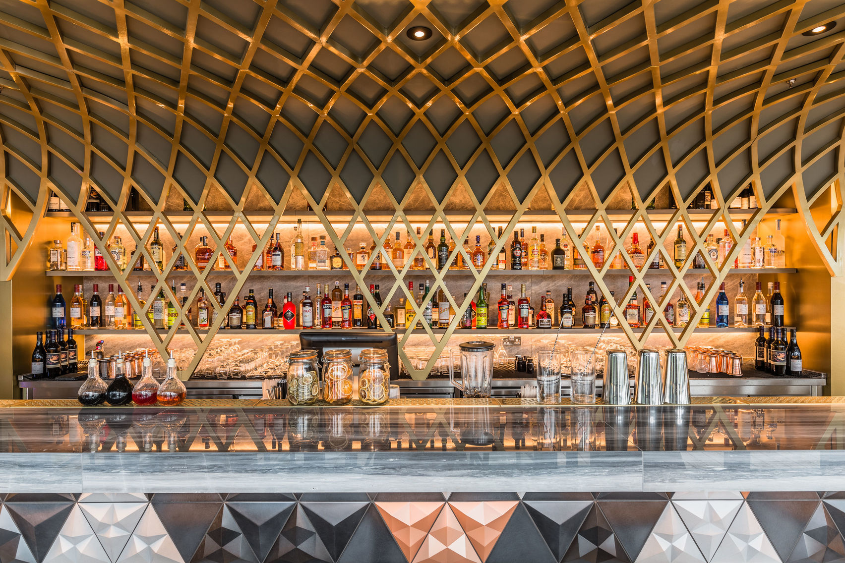 An image of the bar at Jin Bo Law, with copper wiring and dark marble bar
