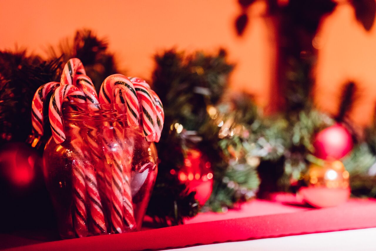 Candy canes and holly as Christmas decorations