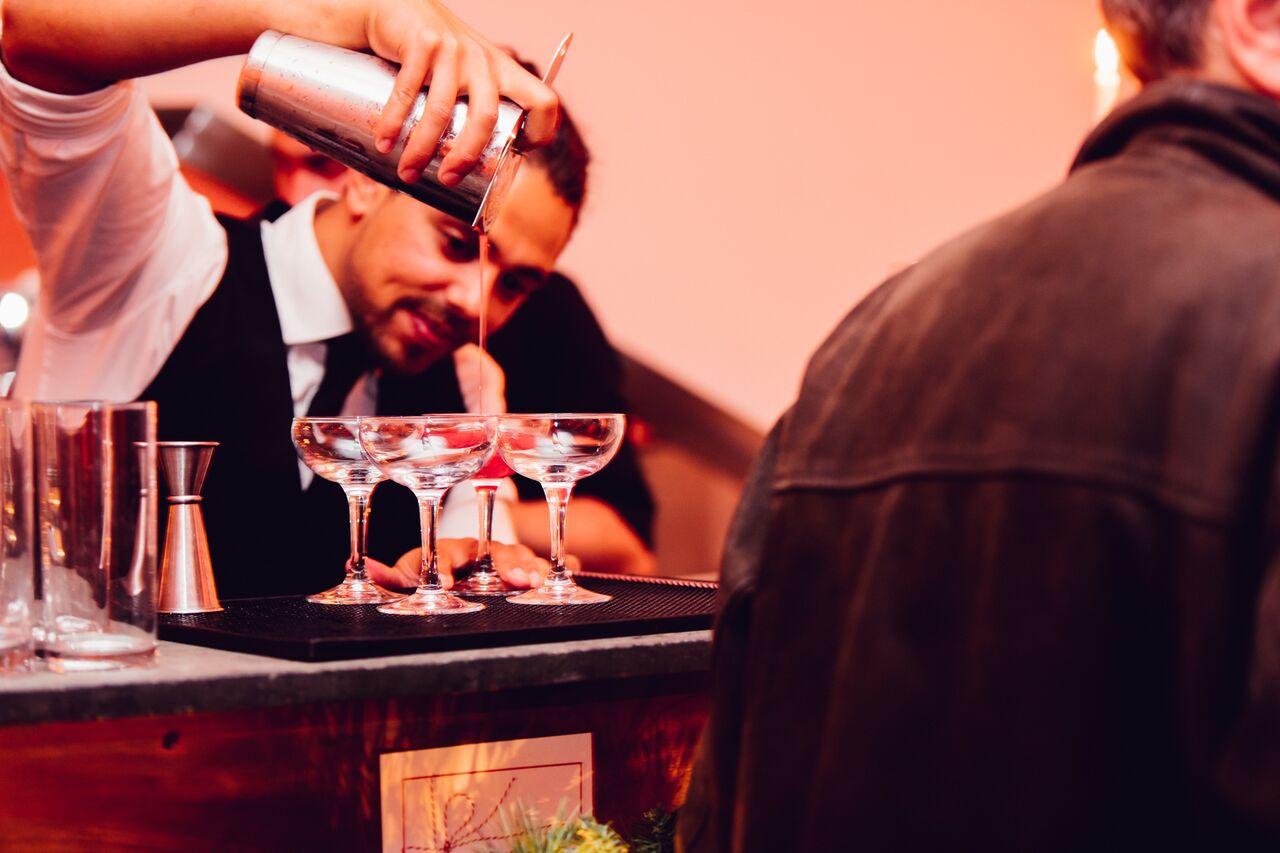 Bartender pouring cocktails at Bourne & Hollingsworth's Christmas pop up