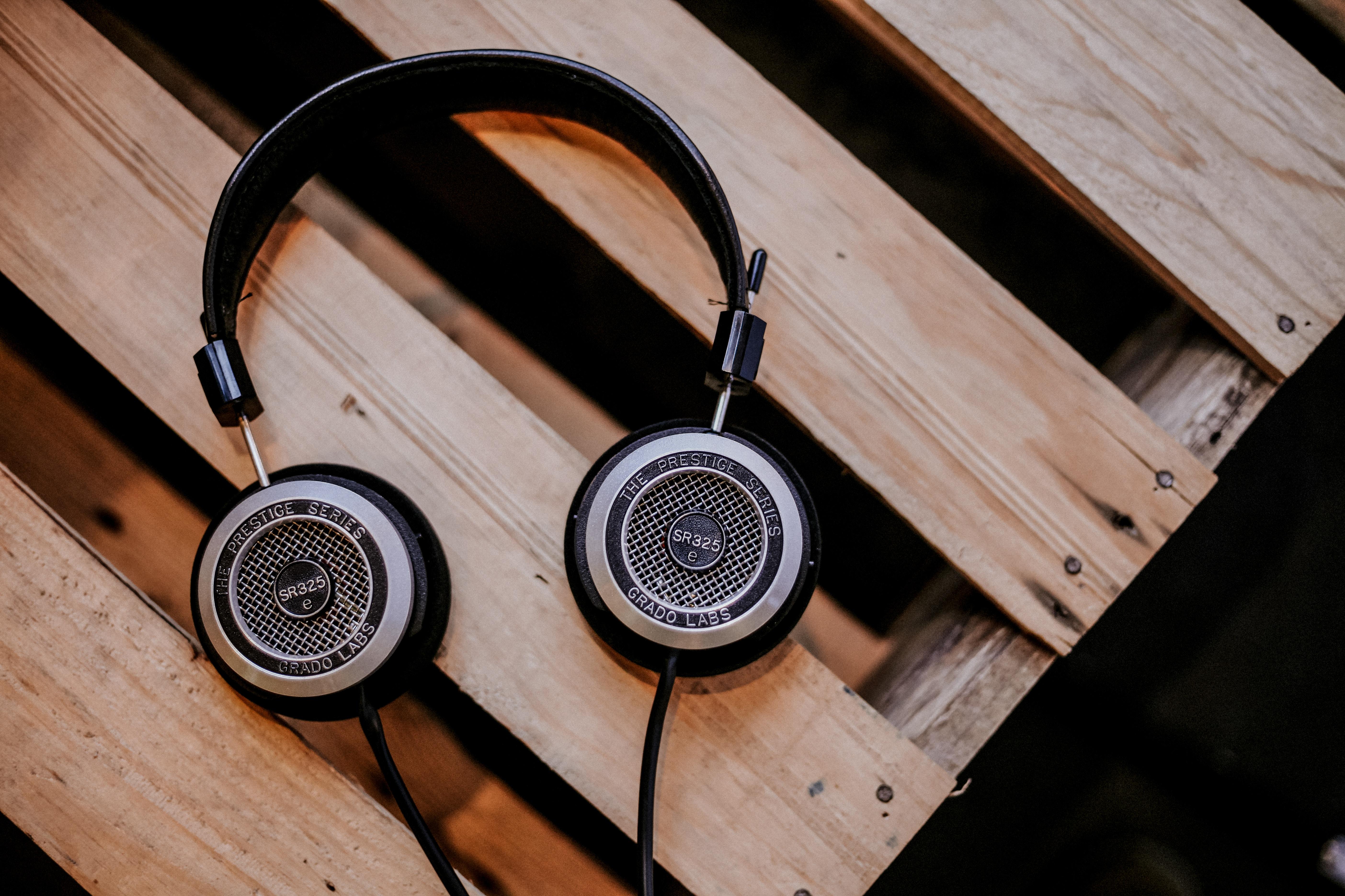 Black headphones on wooden slatted table