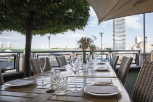 dining table on outdoor terrace with wooden table and chairs
