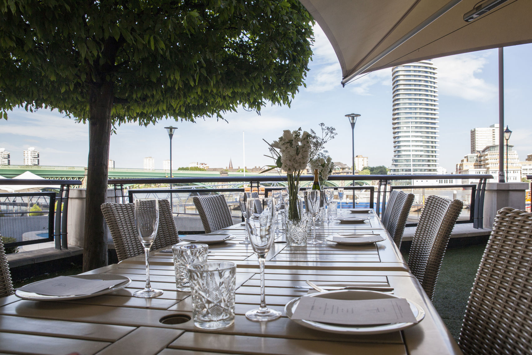 Table on the balcony of The Waterside with views across the river Thames