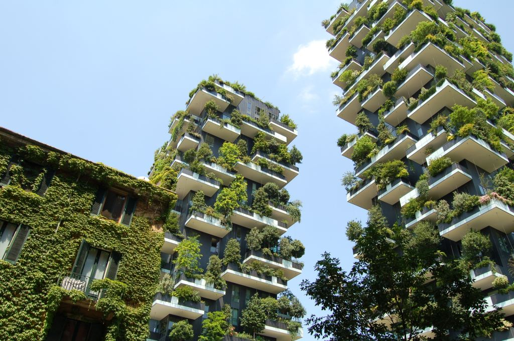 apartment blocks with plants growing on the outside of the buildings