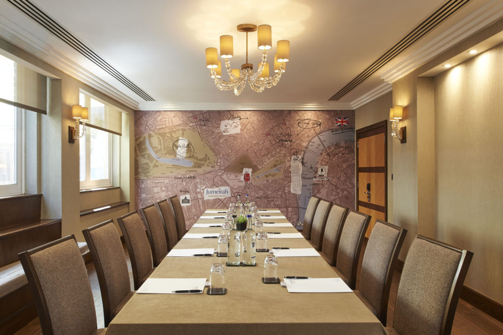 A meeting room in London which has a large map on the back wall.