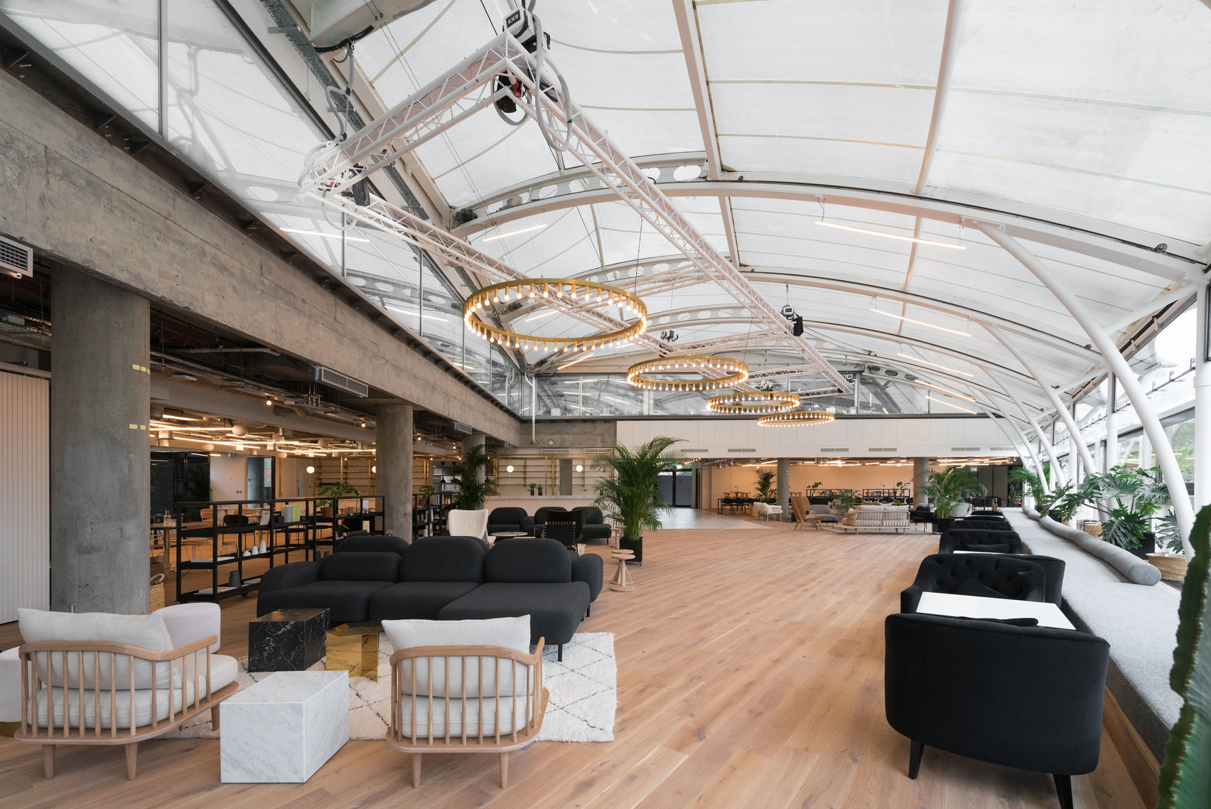 large event space with a glass ceiling and full of natural light