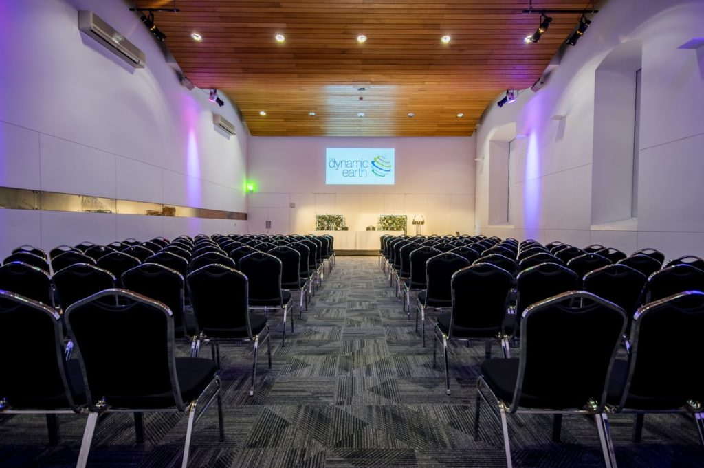 An Edinburgh conference venue with tall ceilings and wooden slatted ceilings