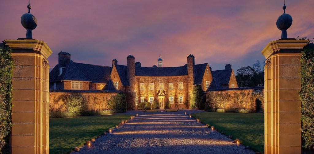 Large event venue Edinburgh in rural surroundings with green lawns either side of a long driveway