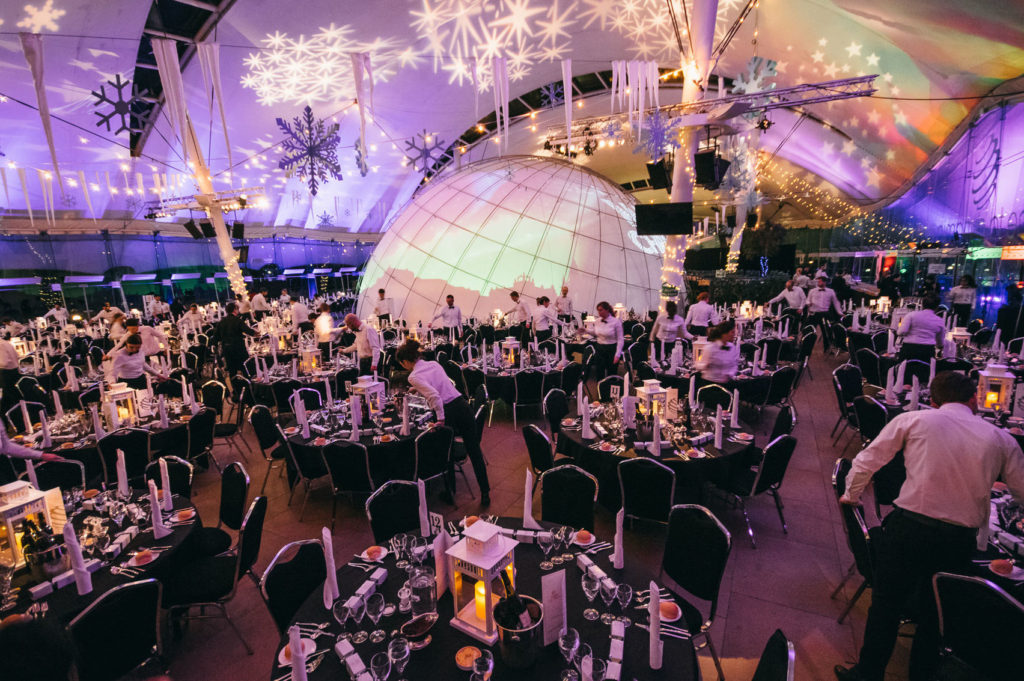 Large domed event venue Edinburgh with round tables and snowflake decorations hanging from the ceiling