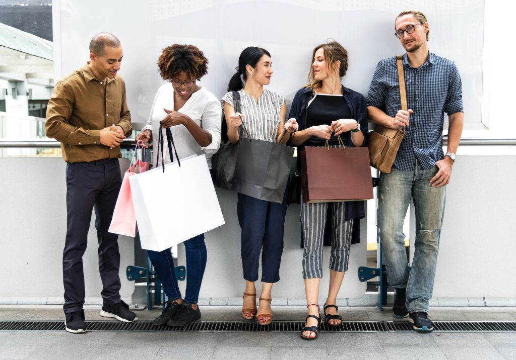 five customers standing for shopping bags