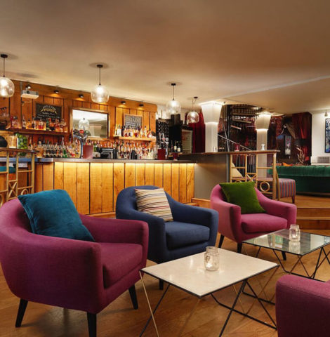 Private party venue with bright coloured furnishings and a bar area