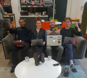 4 people sat on the sofa with laptops